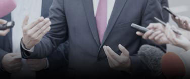 A man in suit showing hand gestures