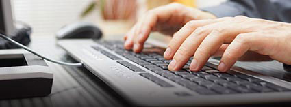 A person typing on keyboard