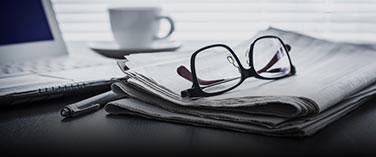 Glasses on Newspaper on a desk